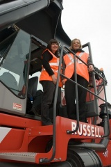 Colette Ranford and Kate Turner, TIRFP project manager, on the Kalmar reach stacker