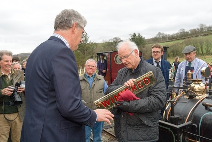 "Julian Birley presents Peter Waterman with a replica nameplate of Quarry Hunslet ""Winifred"" at Llanuwchllyn"